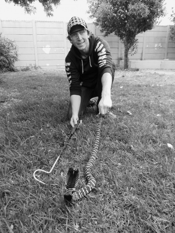 Founder, Grant Smith, handling a rinkhals snake
